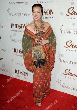 Sue Wong arrives at The Art of Elysiumâ?™s 5th Annual Genesis at Siren Cube on in Los Angeles