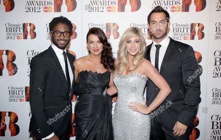 British classical group Amore, from left, Peter Brathwaite, Monica McGhee, Victoria Gray and David Webb arrive at the Royal Albert Hall for the Classical BRIT Awards on in London, UK