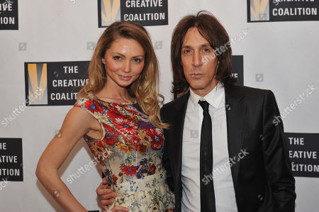 Gia Skova, left, and Warren Tricomi arrive at the Creative Coalition Inaugural Ball, in Washington