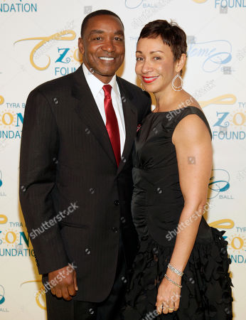 Stock Image of Former professional basketball player Isiah Thomas, left, and his wife Lynn Kendall, right, attend the Flawsome Ball, in New York