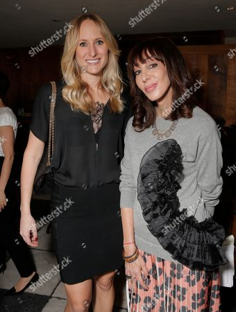 Kim Meyer, left and Merle Ginsberg attend The Hollywood Reporter & Jimmy Choo Celebration of the Most Powerful Stylists in Hollywood,, in West Hollywood, Calif