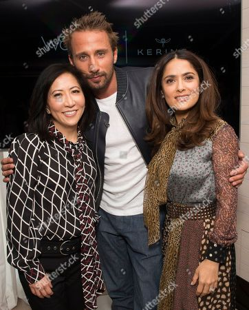 From left, Janice Min, President & Chief Creative Officer of The Hollywood Reporter, Matthias Schoenaerts and Salma Hayek seen at The Hollywood Reporter and Kering Women in Motion conversation at the Majestic Hotel on in Cannes, France