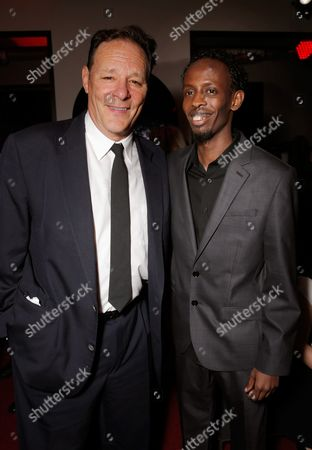 Chris Mulkey, left, and Barkhad Abdi attend The Hollywood Reporter Nominees Night presented by Cadillac, Bing, Delta, Pandora jewelry, Qua, and Zenith, at Spago, in Beverly Hills, Calif