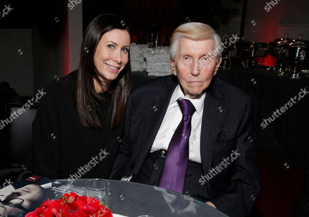 Sydney Holland, left, and Sumner Redstone attends The Hollywood Reporter Nominees Night presented by Cadillac, Bing, Delta, Pandora jewelry, Qua, and Zenith, at Spago, in Beverly Hills, Calif