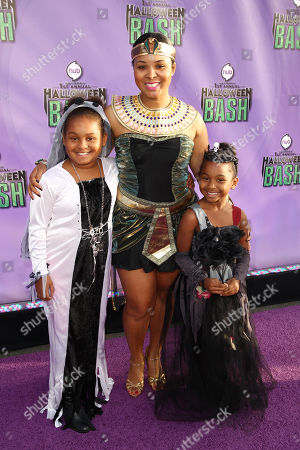 """From left, Mariah Epps, Mechelle Epps and Maddie Epps arrive at """"Hub Network's First Annual Halloween Bash"""", at the Barker Hanger in Santa Monica, Calif. The star-studded special will be broadcasted on the Hub Network on Saturday Oct. 26, 2013"""