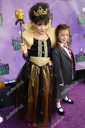 "Chloe Noelle, left, and Aubrey Anderson-Emmons arrive at ""Hub Network's First Annual Halloween Bash"", at the Barker Hanger in Santa Monica, Calif. The star-studded special will be broadcasted on the Hub Network on Saturday Oct. 26, 2013"