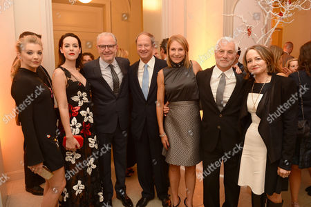 In this photo provided by Lionsgate, Natalie Dormer, Jena Malone, Director Francis Lawrence, U.S. Ambassador to Germany John B. Emerson, Kimberly M. Emerson, Co-Chairman of Lionsgate Motion Picture Group Rob Friedman, and Producer Nina Jacobson at a private dinner celebrating the release of THE HUNGER GAMES: MOCKINGJAY - PART 2 in Berlin