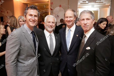 In this photo provided by Lionsgate, Co-President of Lionsgate Motion Picture Group Erik Feig, Co-Chairman of Lionsgate Motion Picture Group Rob Friedman, U.S. Ambassador to Germany John B. Emerson, and Lionsgate CEO Jon Feltheimer at a private dinner celebrating the release of THE HUNGER GAMES: MOCKINGJAY - PART 2 in Berlin