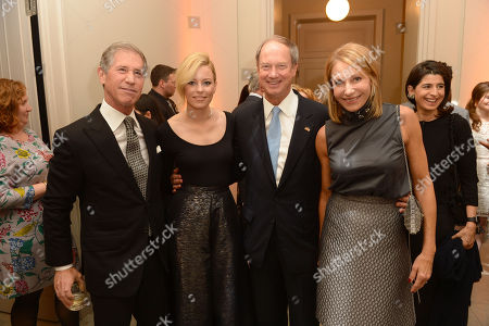 In this photo provided by Lionsgate, Lionsgate CEO Jon Feltheimer, Elizabeth Banks, U.S. Ambassador to Germany John B. Emerson, Kimberly M. Emerson at a private dinner celebrating the release of THE HUNGER GAMES: MOCKINGJAY - PART 2 in Berlin