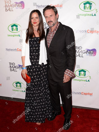 Christina McLarty, left, and David Arquette arrive at THE IMAGINE BALL LA Benefit Concert at the House of Blues, in West Hollywood, Calif