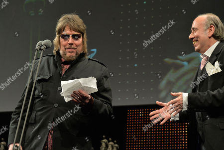 Mick Jones presents Jerry Dammers with the Inspiration Award at the 59th Ivor Novello Awards at the Grosvenor House in London on