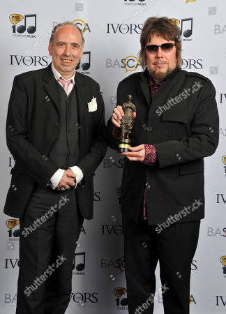 Mick Jones presented Jerry Dammers with his Inspiration Award at the 59th Ivor Novello Awards at the Grosvenor House in London on