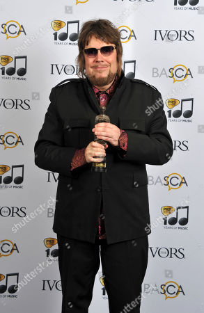 Jerry Dammers poses with his Inspiration Award at the 59th Ivor Novello Awards at the Grosvenor House in London on