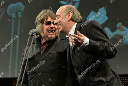 Jerry Dammers, on stage as he collects the Ivors Inspiration Award from Mick Jones at the 59th Ivor Novello Awards at the Grosvenor House in London on