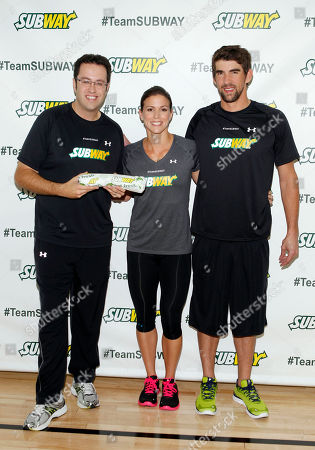 "Former Team SUBWAY marathoner Jared Fogle ""The SUBWAY Guy,"" passes the Footlong baton to Whitney Phelps, sister of Olympic swimming champion Michael Phelps, right, as Whitney announces that she will run the ING New York City Marathon with Team SUBWAY at the Chelsea Piers Sport Center, in New York"