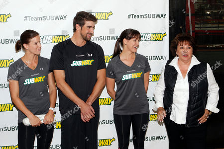 From left, Whitney Phelps, her brother, Olympic swimming champion Michael Phelps, and sister Hilary look on as their mother Debbie speaks after Whitney announced that she will run the ING New York City Marathon with Team SUBWAY at the Chelsea Piers Sport Center, in New York