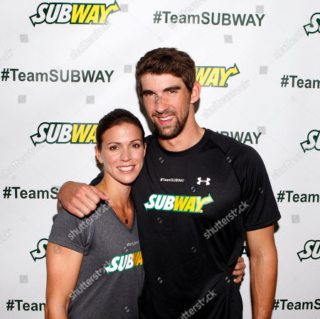 Stock Picture of Whitney Phelps is joined by her bother, Olympic swimming champion Michael Phelps, as as she announces that she will run the ING New York City Marathon with Team SUBWAY at the Chelsea Piers Sport Center, in New York