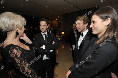 From left, Helen Mirren, Justin Bartha, Jerry Bruckheimer and Lia Smith attend the presentation of the 27th Annual American Cinematheque Award to Jerry Bruckheimer, in Beverly Hills, Calif