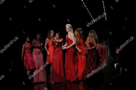 Anika Noni Rose, Left, Rutina Wesley, Thea Andrews, Alicia Quarles, Ireland Baldwin and Bella Thorne walks the runway at the The Red Dress Collection 2014 on in New York