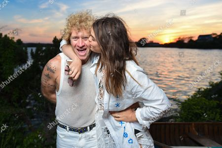 Dan Single, left, and model Bambi Northwood-Blyth attend The Surf Lodge X Zimmermann Collaboration with Solange Knowles and Trombone Shorty, in Montauk, NY