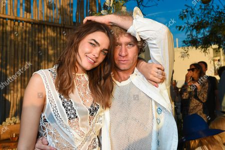 Stock Picture of Dan Single, right, and model Bambi Northwood-Blyth attend The Surf Lodge X Zimmermann Collaboration with Solange Knowles and Trombone Shorty, in Montauk, NY