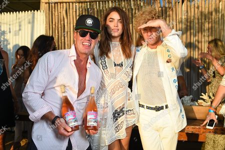Photographer Ben Watts, left, Bambi Northwood-Blyth, middle, and Dan Single attend The Surf Lodge X Zimmermann Collaboration with Solange Knowles and Trombone Shorty, in Montauk, NY