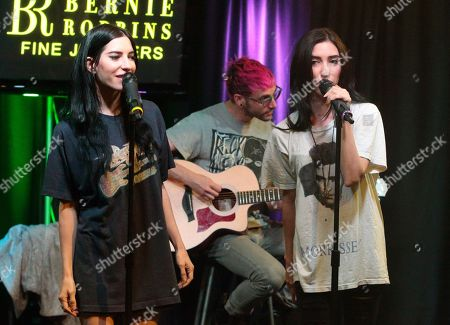 Lisa Origliasso, left, and Jessica Origliasso of the band The Veronicas visit the Mix 106.1 Performance Theater, in Philadelphia