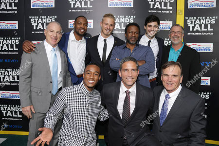 Producer David Zelon, Ser'Darius Blain, Jessie Usher, Alexander Ludwig, Jim Caviezel, Director Thomas Carter, Matthew Daddario, Coach Bob Ladouceur and Assistant Coach Terry Eidson seen at The World Premiere of Tri Star Pictures' 'When The Game Stands Tall' at ArcLight Cinemas Hollywood, in Los Angeles