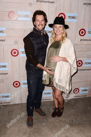 TOMS Founder Blake Mycoskie, left, and his wife Heather Lang attend the celebration for the TOMS for Target holiday partnership at The BookBindery on in Culver City, Calif