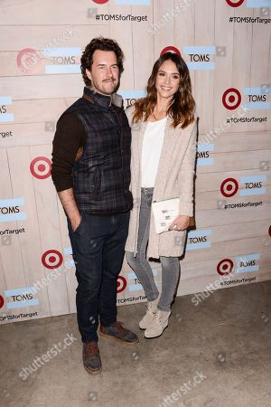 Actress Jessica Alba, right, and TOMS Founder Blake Mycoskie attend the celebration for the TOMS for Target holiday partnership at The BookBindery on in Culver City, Calif