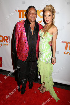 Stock Photo of Sir Ivan Wilzig, left, and Mina Otsuka attend the TrevorLIVE Benefit at the Marriott Marquis, in New York