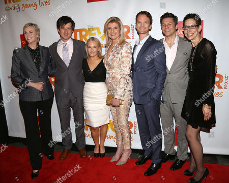 From left, Jane Lynch, Christian Hebel, Rachael Harris, Arianna Huffington, Neil Patrick Harris, David Burtka and Abbe Land attend the TrevorLIVE Benefit at the Marriott Marquis, in New York