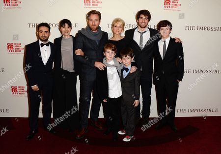 L-R) Director Juan Antionio Bayona, film subject Maria Belon, actor Ewan McGregor, actress Naomi Watts, film subject Lucas Belon and actors Tom Holland, Samual Joslin and Oaklee Pendergast are seen at the UK Premiere of The Impossible at Odeon BFI IMAX, in London