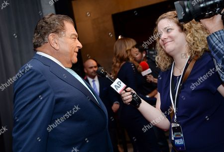 """Television personality Mario Kreutzberger, aka Don Francisco, chats with Associated Press reporter Alicia Rancilio, at an event hosted by The Univision Network & The Paley Center for Media, honoring """"Don Francisco"""" for his contributions in broadcasting while hosting the """"Sabado Gigante"""" variety show, in New York"""