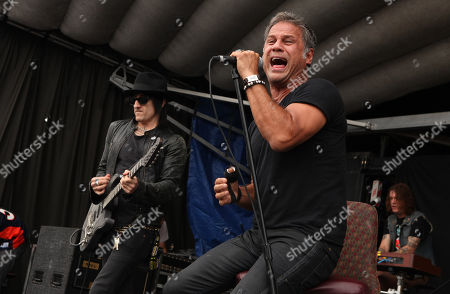 Richard Fortus, Jon Stevens and Dizzy Reed of The Dead Daisies perform during the Rockstar Energy Drink Uproar Festival at the First Midwest Bank Amphitheatre, on in Tinley Park, IL