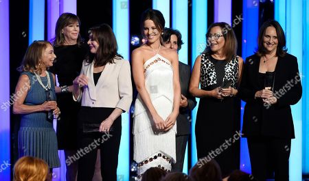 Presenter Kate Beckinsale, fourth from left, poses with the recipients of the Crystal Award for Excellence in Film at the Women in Film 2016 Crystal + Lucy Awards at the Beverly Hilton, in Beverly Hills, Calif. From left are producers Lynda Obst, Jane Rosenthal, Lauren Shuler Donner, Lianne Halfon, Denise Di Novi and Lucy Fisher