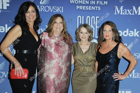 Jane Fleming, Gail Berman-Masters, Gayle Nachlis, and Cathy Schulman arrive at Women in Film's 2013 Crystal + Lucy Awards at The Beverly Hilton Hotel on in Beverly Hills, Calif