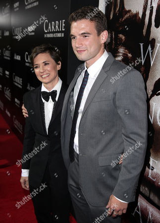 "Director Kimberly Peirce, left, and Alex Russell pose together on the red carpet of the world premiere of ""Carrie"" at the ArcLight Hollywood on in Los Angeles"