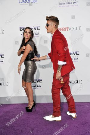 "Pattie Mallette, left, and Justin Bieber arrive at the World Premiere of ""Justin Bieber's Believe"" at Regal Cinemas L.A. Live on in Los Angeles"