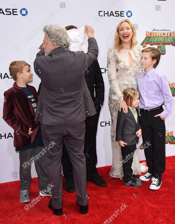 """Dustin Hoffman covers Jack Black's face as Black's son, Samuel Black, left, Kate Hudson, third from right, and her sons from right, Ryder Robinson and Bingham Hawn Bellamy look on at the world premiere of """"Kung Fu Panda 3"""" at the TCL Chinese Theatre, in Los Angeles"""