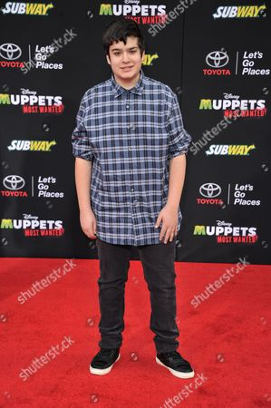 """Stock Image of Devan Leos arrives at the World Premiere of """"Muppets Most Wanted"""", in Los Angeles"""