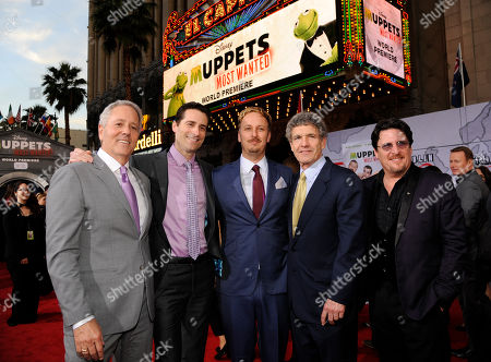 "Muppets Most Wanted"" director/co-writer James Bobin, center, poses with, left to right, producers David Hoberman and Todd Lieberman, Walt Disney Studios Chairman Alan Horn and puppeteer/producer Bill Barretta at the premiere of the film, in Los Angeles"