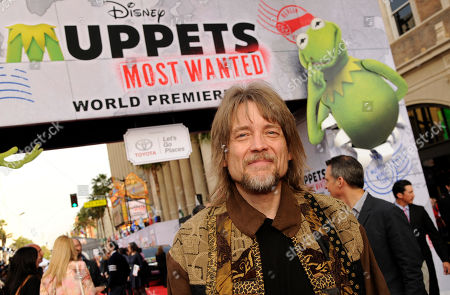 "Puppeteer Steve Whitmire poses at the premiere of the film ""Muppets Most Wanted"", in Los Angeles"