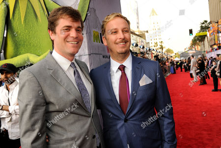 """James Bobin, right, director/co-writer of """"Muppets Most Wanted,"""" poses with executive producer/co-writer Nick Stoller at the premiere of the film, in Los Angeles"""