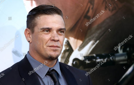 "Brandon Auret arrives at the world premiere of ""Elysium"" at the Regency Village Theater on in Los Angeles"