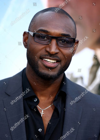 "Adrian Holmes arrives at the world premiere of ""Elysium"" at the Regency Village Theater on in Los Angeles"
