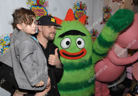 Joel Madden, left, and son Sparrow Madden pose with Brobee at Yo Gabba Gabba! Live!: Get The Sillies Out! 50+ city tour kick-off performance on Thanksgiving weekend at Nokia Theatre L.A. Live on in Los Angeles