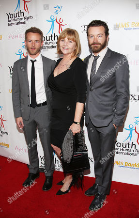 Stock Photo of From left, Chris Masterson, Carol Masterson, and Danny Masterson arrive at the Youth for Human Rights International Celebrity Benefit at Beso Hollywood,, in Los Angeles