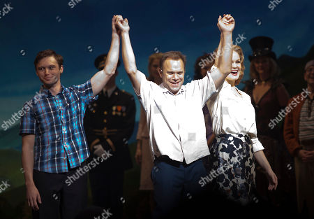 From left, actors Bobby Steggert, Norbert Leo-Butz and Kate Baldwin take a bow during curtain call for the 'Big Fish' Broadway Opening Night on Sunday, October, 7, 2013 in New York