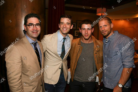 """From left, Playwright Jonathan Tolins, cast member Michael Urie, singer/actor Nick Jonas and actor Matt Lauria pose during the party for the opening night performance of """"Buyer & Cellar"""" at the Center Theatre Group/Mark Taper Forum, in Los Angeles, Calif"""
